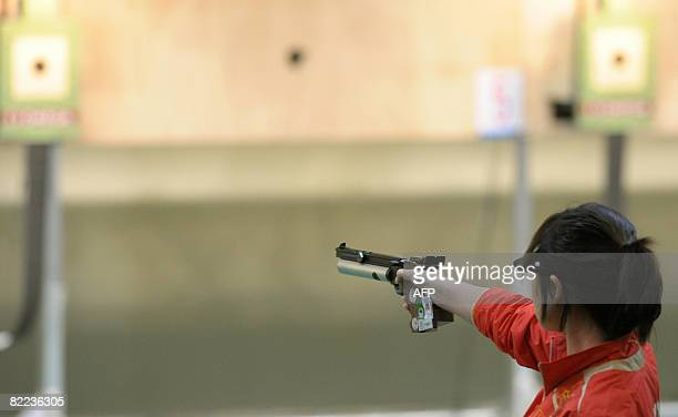 Guo Wenjun of China aims her pistol during the women's 10m Air Pistol category at the 2008 Beijing Olympic Games on August 10 2008 at the Beijing...
