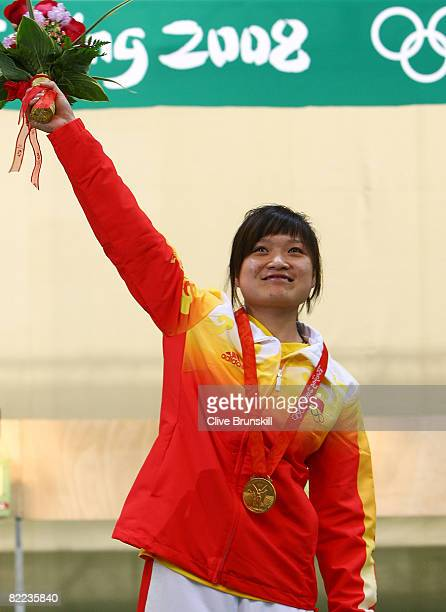 Guo Wenjun of China celebrates after winning the gold medal in the women's 10m air pistol final shooting event held at the Beijing Shooting Range...