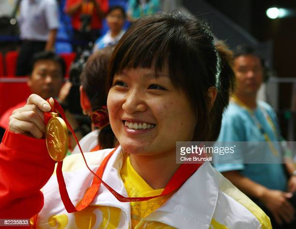Guo Wenjun of China poses with her gold medal in the women's 10m air pistol final shooting event held at the Beijing Shooting Range Hall during Day 2...
