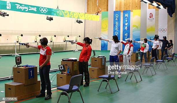 Guo Wenjun of China shoots with competitors on her way to winning the gold medal in the women's 10m air pistol final shooting event held at the...