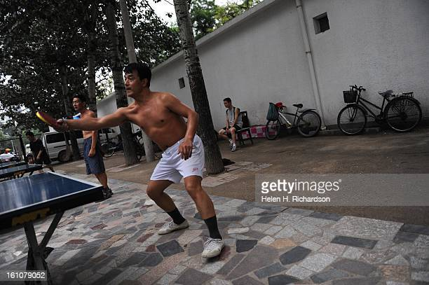 Guo Xi La has a spirited game of ping pong in the early evening at this local ping pong park in Beijing Ping pong is as popular in China as baseball...