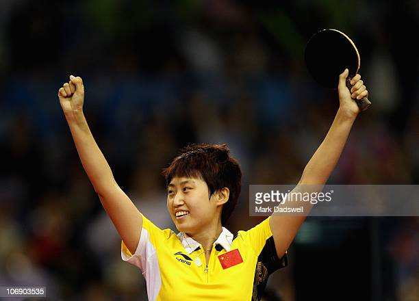 Guo Yue of China celebrates her win in the Women's Team Gold Medal Contest against Li Jiawei of Singapore at Guangzhou Gymnasium during day four of...