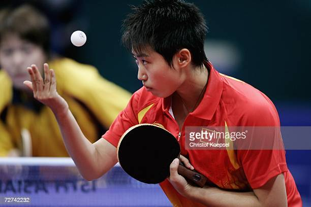 Guo Yue of China serves against Tie Ya Na and Zhang Rui of Hong Kong China during the Women's Doubles Final Table Tennis Competition at the 15th...