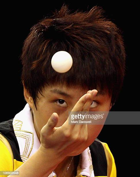 Guo Yue of China serves in her Women's Team Gold Medal Contest against Li Jiawei of Singapore at Guangzhou Gymnasium during day four of the 16th...