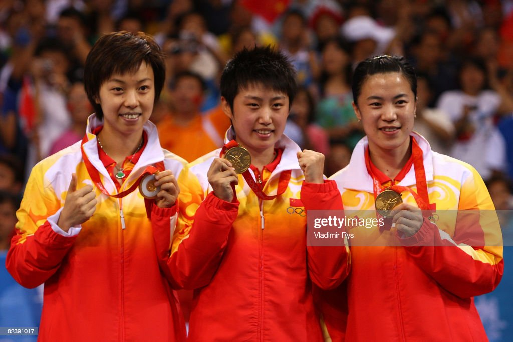 Guo Yue, Wang Nan and Zhang Yining of China pose after winning the gold medal in the Women's Team Gold Medal Contest table tennis event held at the Peking University Gymnasium during Day 9 of the 2008 Beijing Summer Olympic Games on August 17, 2008 in Beijing, China.
