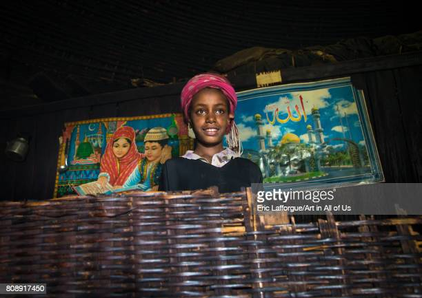 Gurage girl inside her traditional house decorated with muslim posters on the walls Gurage Zone Butajira Ethiopia on June 18 2017 in Butajira Ethiopia
