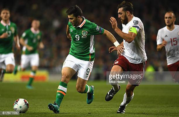 Guram Kashia of Georgia chases down Shane Long of Republic of Ireland during the FIFA 2018 World Cup Group D Qualifier between Republic of Ireland...