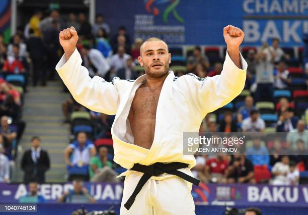 Guram Tushishvili from Georgia celebrates his victory against Ushangi Kokauri from Azerbaijan in the men's over 100kg category gold medal bout of the...