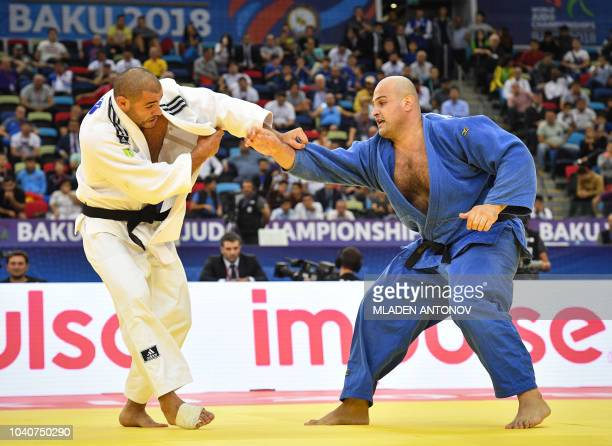 Guram Tushishvili from Georgia fights against Ushangi Kokauri from Azerbaijan in the men's over 100kg category gold medal bout of the 2018 Judo World...