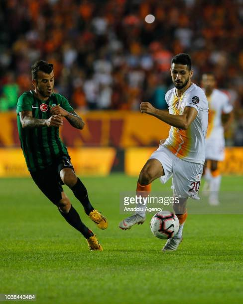 Guray Vural of Akhisarspor in action against Emre Akbaba of Galatasaray during Turkish Super Lig soccer match between Akhisarspor and Galatasaray at...