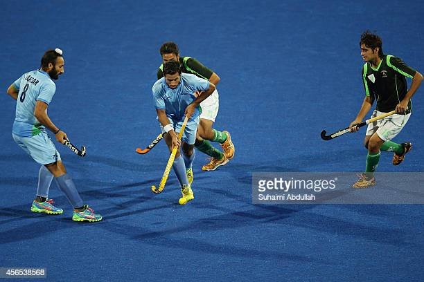 Gurbaj Singh of India controls the ball during the men's hockey gold medal match on day thirteen of the 2014 Asian Games between India and Pakistan...