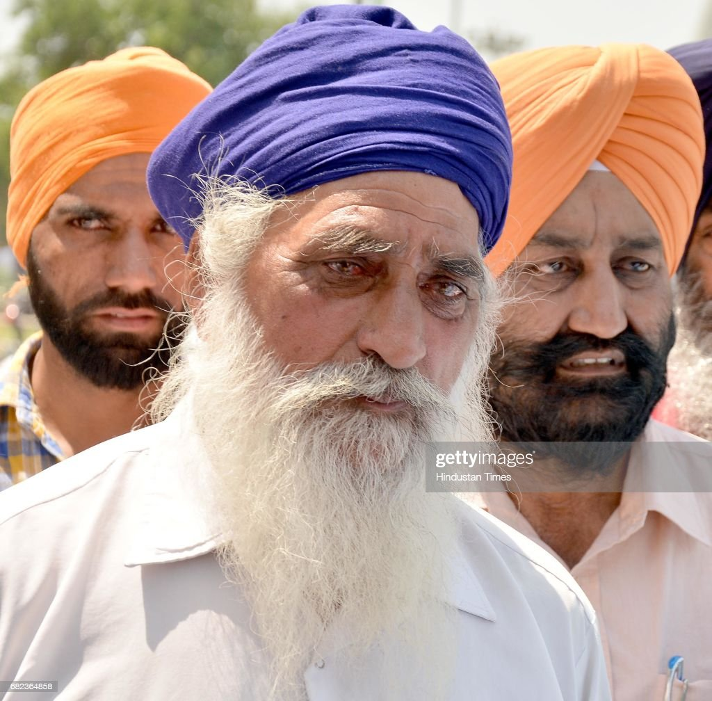 Gurcharan Singh father of deceased Amarjit Singh at Sri Guru Ram Dass Jee International Airport to receive his body on May 12 2017 in Amritsar India..