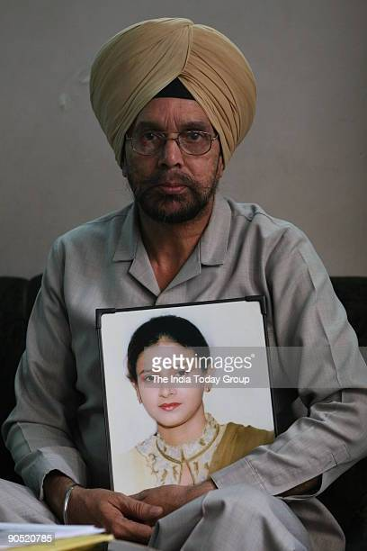 Gurcharan Singh with the photograph of Puneet who was killed in 2004 for dowry