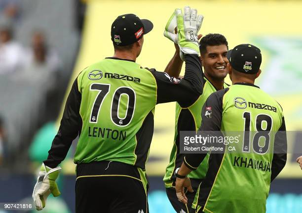 Gurdinder Sandhu of the Thunder takes the wicket of Seb Gotch of the Stars during the Big Bash League match between the Melbourne Stars and the...