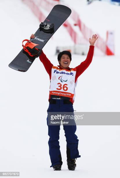 Gurimu Narita of Japan celebrates during the victory ceremony after winning the Gold medal for the Men's Banked Slalom SBLL2 Snowboard during day...