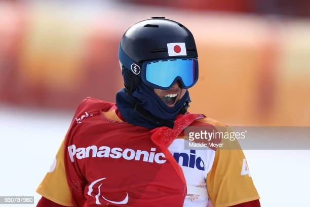 Gurimu Narita of Japan celebrates winning bronze in the the Men's Snowboard Cross SBLL2 during day three of the PyeongChang 2018 Paralympic Games on...