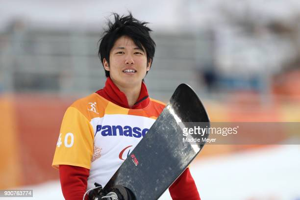 Gurimu Narita of Japan is all smiles after winning the Bronze medal in the Men's Snowboard Cross SBLL2 during day three of the PyeongChang 2018...