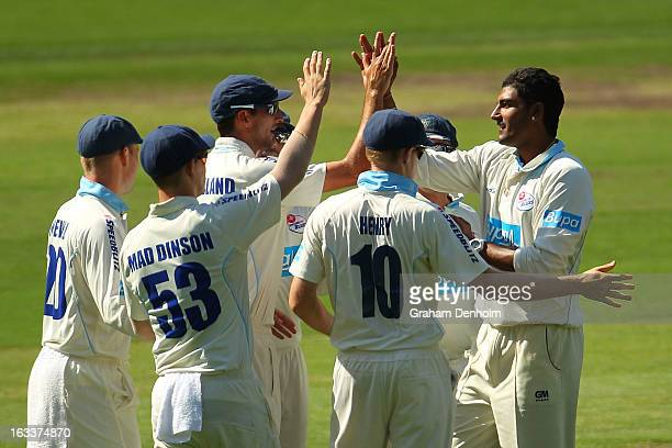Gurinder Sandhu and Trent Copeland of the Blues high five after David Hussey of the Bushrangers was caught out by Copeland from the bowling of Sandhu...