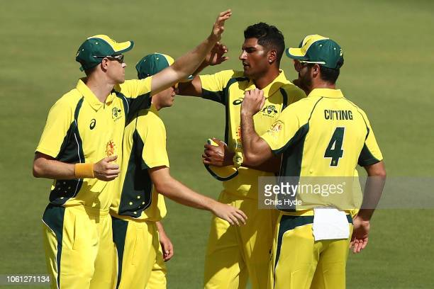 Gurinder Sandhu of CXI celebrates with team mates after dismissing Aiden Markram of South Africa during the International Tour match between the CXI...