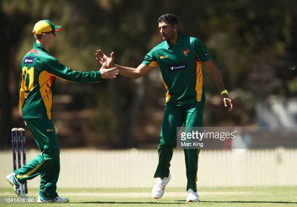 Gurinder Sandhu of Tasmania celebrates taking the wicket of Alex Ross of South Australia during the JLT One Day Cup match between South Australia and...