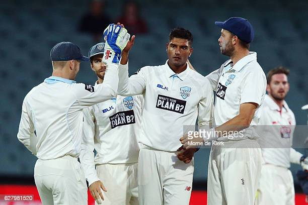 Gurinder Sandhu of the NSW Blues is congratulated by teammates after getting the wicket of Alex Carey of the SA Redbacks during day two of the...