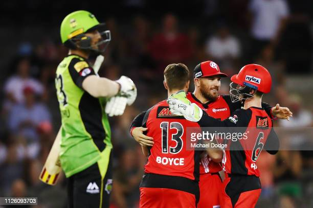 Gurinder Sandhu of the Thunder Aaron Finch of the Renegades celebrates the win with Cameron Boyce and Sam Harper during the Big Bash League match...