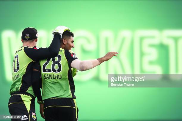 Gurinder Sandhu of the Thunder celebrates after claiming the wicket of Sam Harper of the Renegades during the Big Bash League match between the...