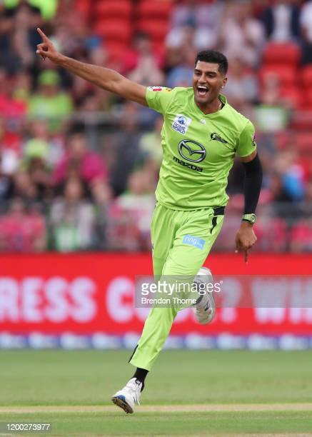 Gurinder Sandhu of the Thunder celebrates after claiming the wicket of Josh Philippe of the Sixers during the Big Bash League match between the...