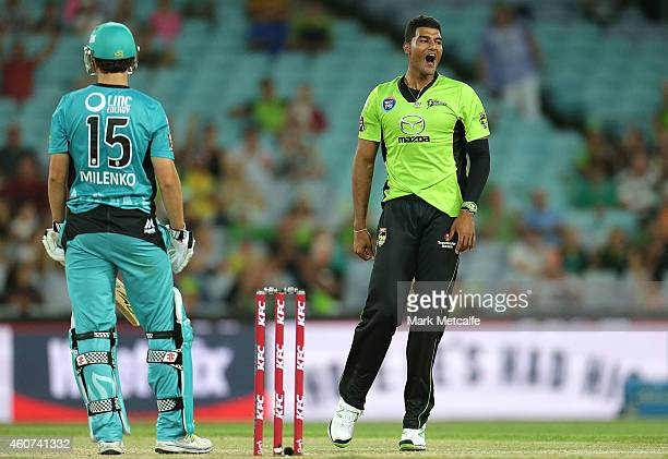 Gurinder Sandhu of the Thunder celebrates taking the wicket of Simon Milenko of the Heat during the Big Bash League match between the Sydney Thunder...