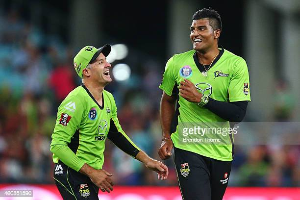 Gurinder Sandhu of the Thunder celebrates with team mate Mike Hussey after claiming the wicket of Jordan Silk of the Sixers during the Big Bash...