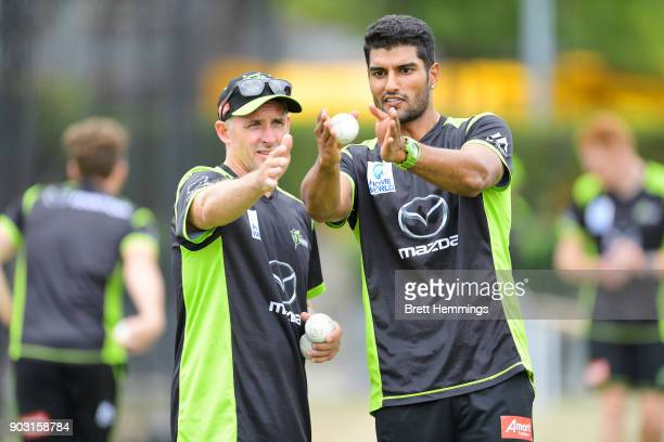 Gurinder Sandhu of the Thunder speaks with Mike Hussey poses during the Sydney Thunder Big Bash League training session at Spotless Stadium on...