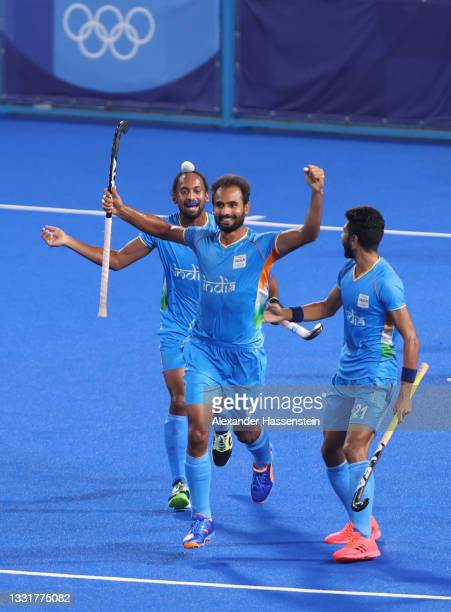 Gurjant Singh of Team India celebrates with teammates Hardik Singh and Shamsher Singh after scoring their team's second goal during the Men's...