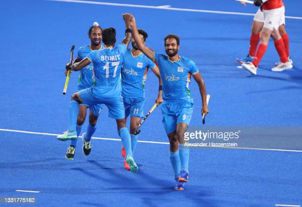 Gurjant Singh of Team India celebrates with teammates Sumit, Hardik Singh and Shamsher Singh after scoring their team's second goal during the Men's...