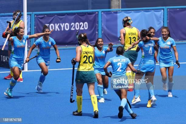 Gurjit Kaur of Team India celebrates scoring the first goal with teammates while Karri Somerville and Edwina Bone of Team Australia walk away during...