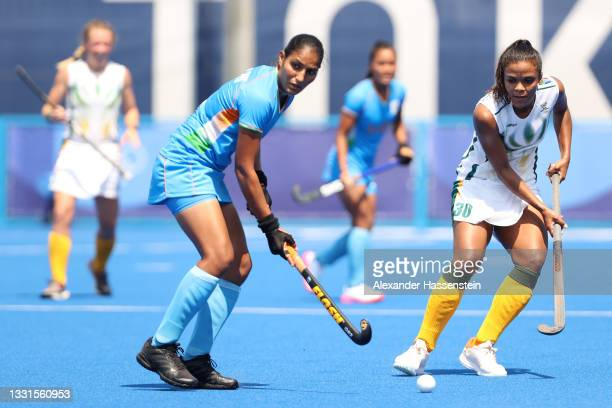 Gurjit Kaur of Team India controls the ball against Toni Marks of Team South Africa during the Women's Preliminary Pool A match between India and...