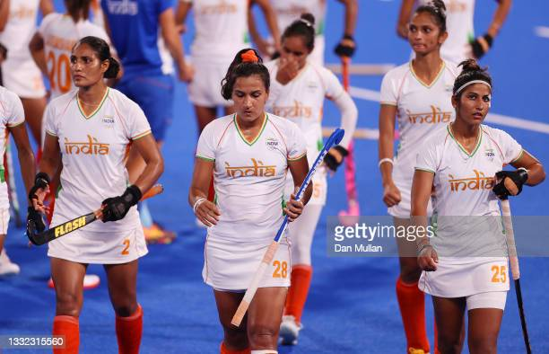 Gurjit Kaur, Rani and Navneet Kaur of Team India leave the pitch following a loss in the Women's Semifinal match between Argentina and India on day...