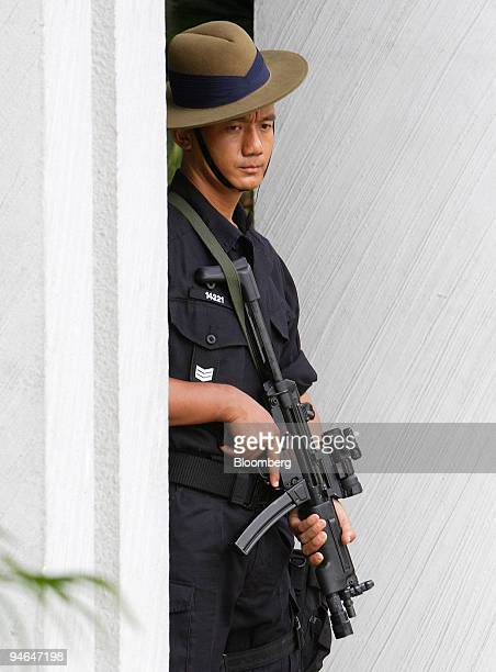 Gurkha armed with an automatic rifle stands guard outside the ShangriLa Hotel venue for the Asia Security Summit in Singapore on Friday June 1 2007...