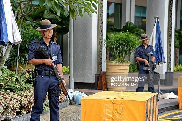 Gurkha contingent from the Singapore police force stand guard outside ShangriLa hotel where the 15th IISS ShangriLa Dialogue will be held in...