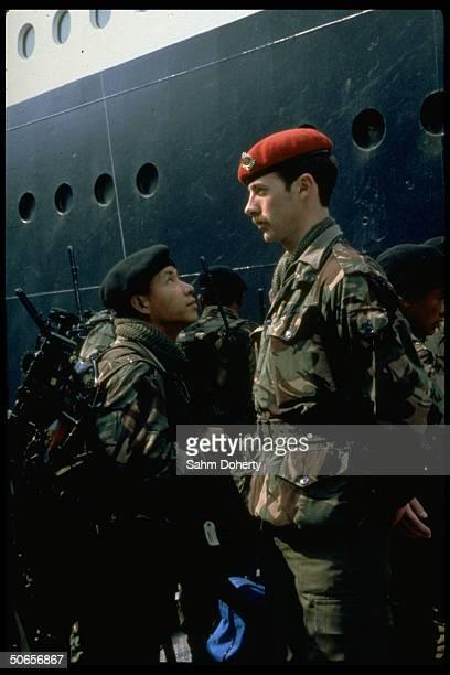 Gurkha Rifles soldier preparing to board QE2 for Falklands