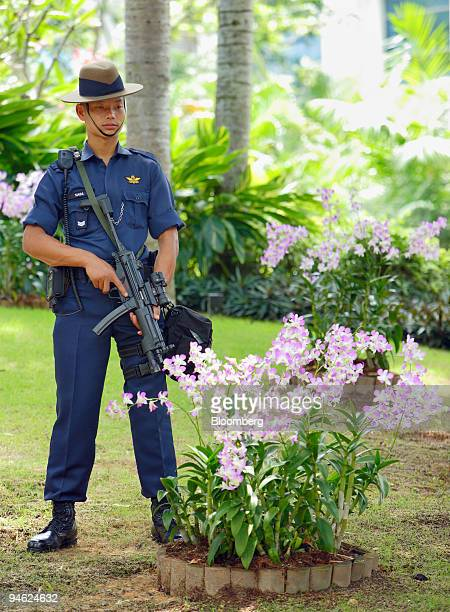 Gurkha soldier working for the Singapore Police Force stands guard armed with an automatic weapon in front of the ShangriLa Hotel the venue for the...