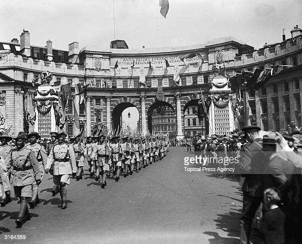 Indian soldiers marching through Admiralty Arch to the Cenotaph during the London Peace Pageant