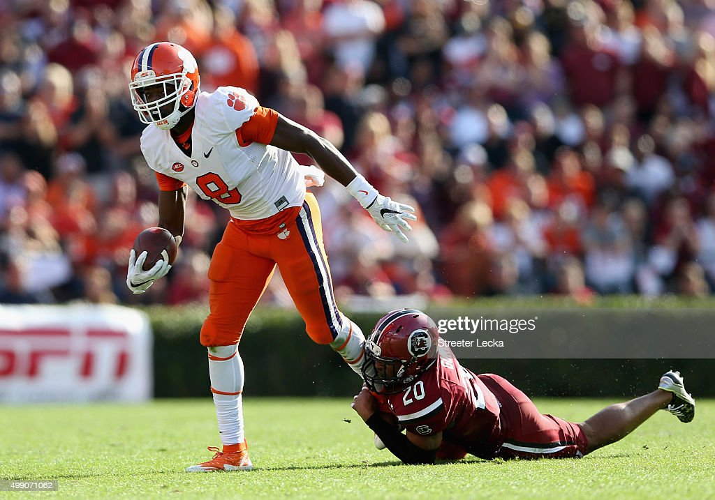 T.J. Gurley #20 of the South Carolina Gamecocks tries to tackle Deon Cain #8 of the Clemson Tigers during their game at Williams-Brice Stadium on November 28, 2015 in Columbia, South Carolina.