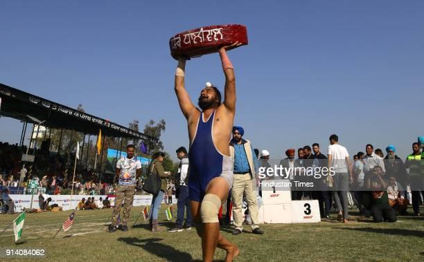 Gurmeet Singh lifting 90 kg stone on the 2nd day of the 82nd Kila Raipur Rural Olympics 2018 in the village Kila Raipur on February 3 in Ludhiana...