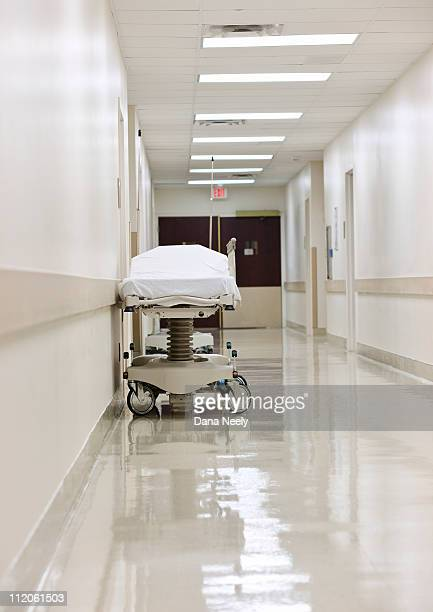 gurney in hospital corridor. - newhealth stock photos and pictures
