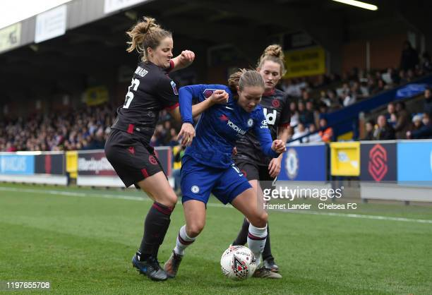 Guro Reiten of Chelsea is challenged by Sophie Howard of Reading and Rachel Rowe of Reading during the Barclays FA Women's Super League match between...