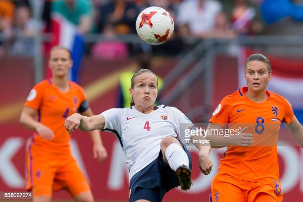 Guro Reiten of Norway and Sherida Spitse of the Netherlands battle for the ball during their Group A match between Netherlands and Norway during the...
