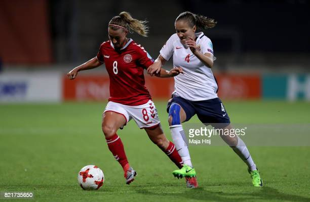 Guro Reiten of Norway and Theresa Nielsen of Denmark compete for the ball during the Group A match between Norway and Denmark during the UEFA Women's...