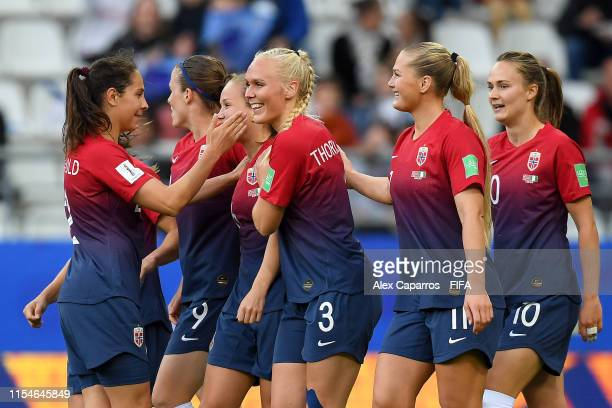 Guro Reiten of Norway celebrates with teammates after scoring her team's first goal during the 2019 FIFA Women's World Cup France group A match...
