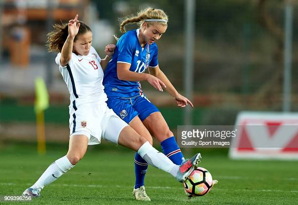 Guro Reiten of Norway competes for the ball with Andrea Hauksdottir of Iceland during the international friendly match between Norway Women and...