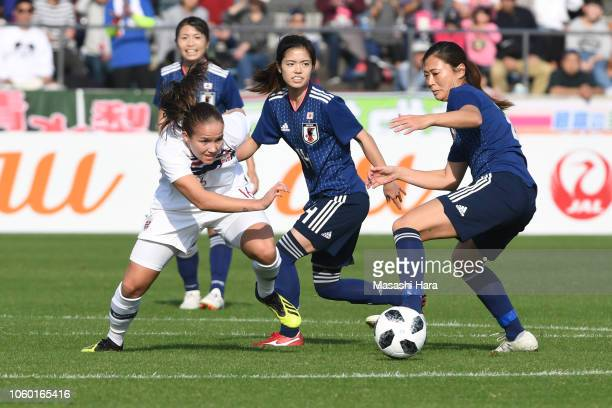 Guro Reiten of Norway Rumi Utsugi and Yui Hasegawa of Japan compete for the ball during the international friendly match between Japan and Norway at...